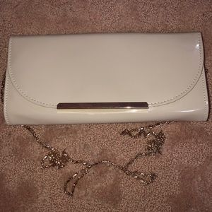 Patent nude leather clutch on gold chain